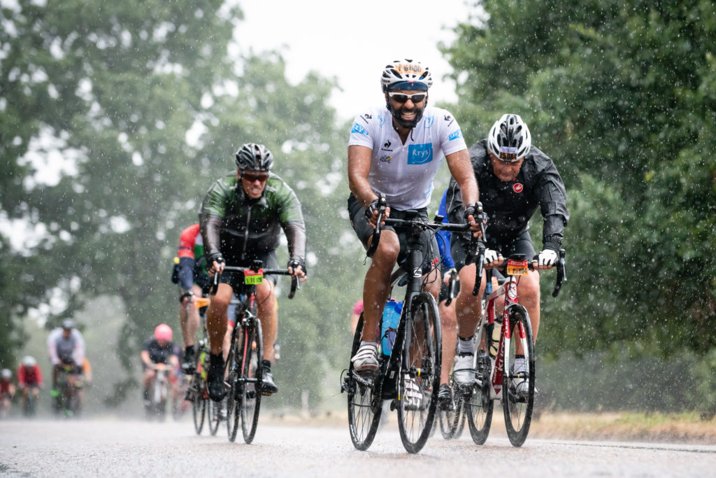 Riders cycle through Richmond Park in the rain during Ride London 2018 // www.sportsphotographer.co.uk